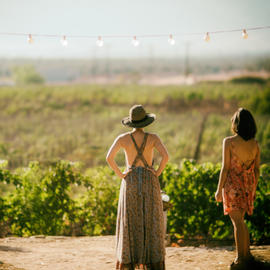 girl standing overlooking vineyard